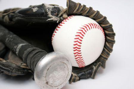 Baseballs, Glove and Bat in closeup photo