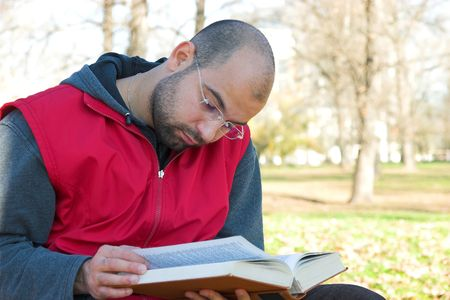 student reading: student reading book in park Stock Photo