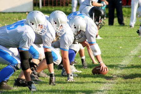 tackles: football players, offense – defense in action Stock Photo