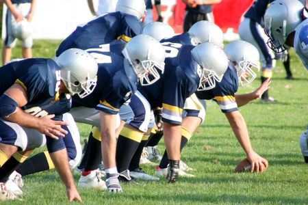 football players, offense � defense in action Stock Photo