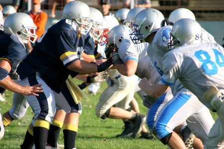 vigorously: football players, offense � defense in action Stock Photo