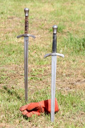 knightly: two swords and gauntlet