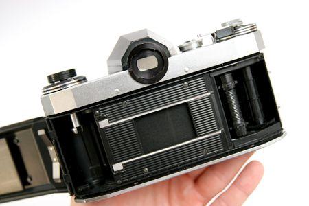 Manejar la cámara de fotos réflex, en el interior Foto de archivo - 713429