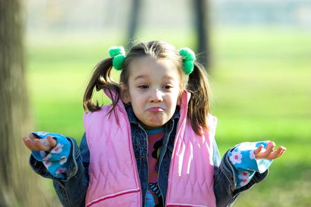 to know: a little pretty girl giving a shrug,  dont know Stock Photo