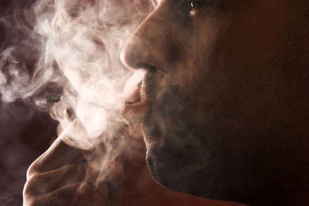 macho man: close up of an smoking man