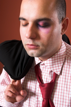 dissent: attacked a Businessman with black eye