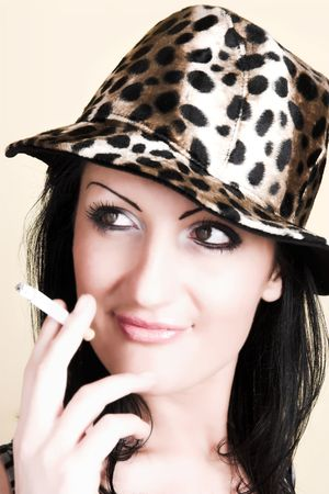 beautiful brunette young woman with cigar photo