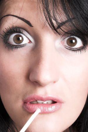 woman applying lipstick Stock Photo - 835121