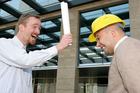 angry architect and businessman with architectural plans photo