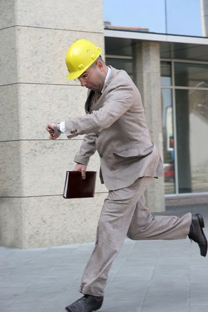 A businessman panic running late for a meeting Stock Photo - 884744
