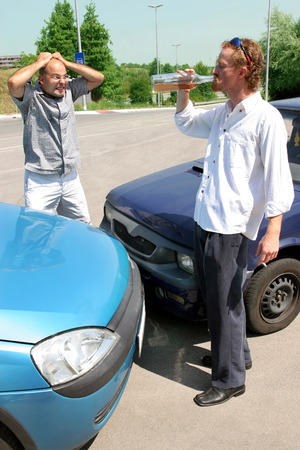 accident two cars, angry businessman and drunk man holding a bottle alcohol Stock Photo - 1448953
