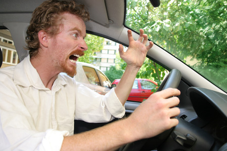 rough road: angry driver in the car Stock Photo