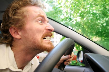 enraged: angry driver in the car Stock Photo