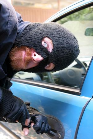burglar wearing a mask (balaclava), car burglary Stock Photo - 1448797