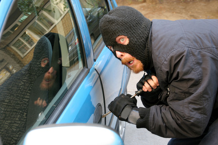 larceny: burglar wearing a mask (balaclava), car burglary