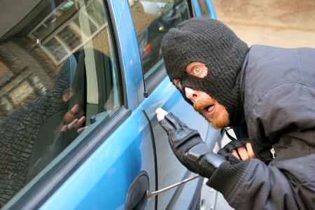 burglar wearing a mask (balaclava), car burglary photo