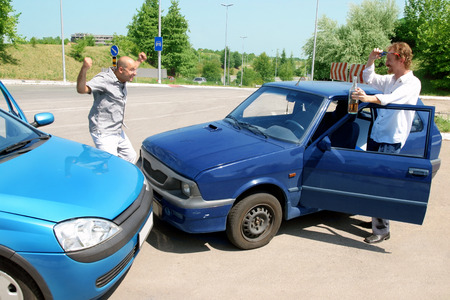 accident two cars, angry businessman and drunk man holding a bottle alcohol photo