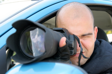 press agent: Professional photographer in action with telephoto lens, paparazzi