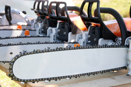 details several new chainsaws