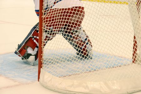 Ice hockey gatekeeper and hockey net Stock Photo