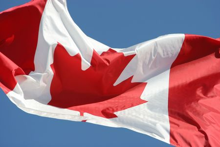Waving flag of Canada in blue sky background Stock Photo