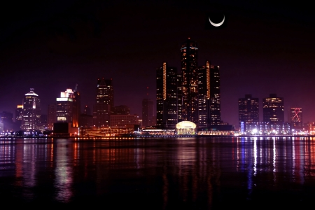 view of Detroit skyline at night and moon, Michigan Stock Photo