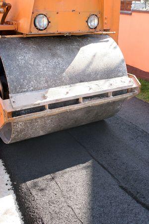 flatten: road construction roller leveling new asphalt on road