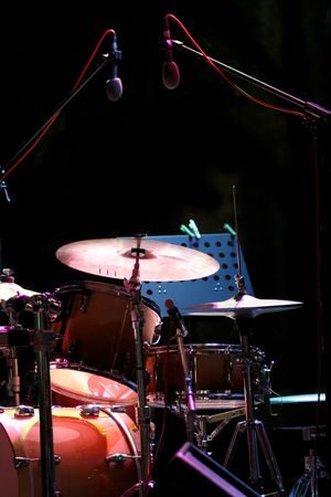 jazz: drum kit on the stage, concert of searchlights