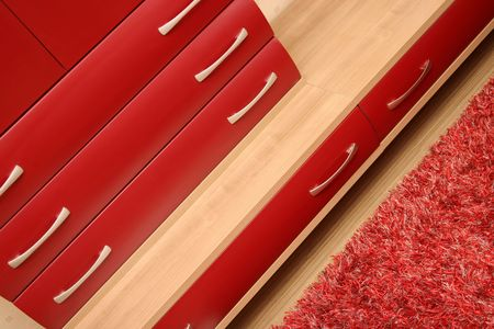 Details of red drawer in sitting-room, wooden interior Stock Photo - 2433005