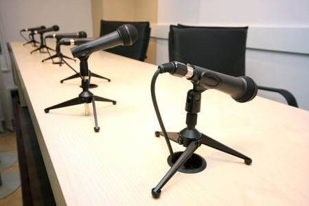 Press Conference, conference room with microphones in row photo