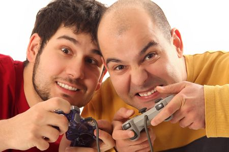 Two young men playing video game console controller Stock Photo