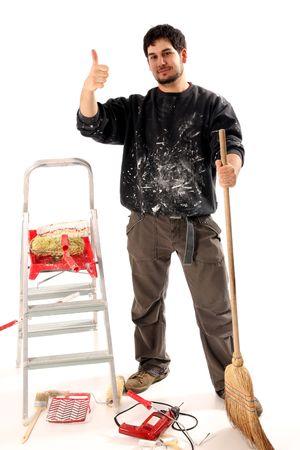 perito: contenga a pintor con el rodillo de la pintura en el fondo blanco Foto de archivo