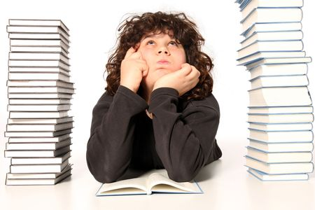 boy thinking and reading a book on white background Stock Photo
