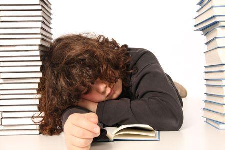 boy sleeping and and many books on white background photo