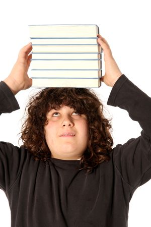 huh: boy with books on head on white background Stock Photo