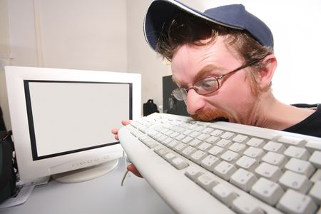 computer problems: mad programmer sitting at a computer desk