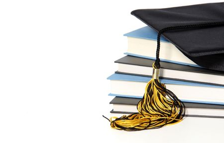 graduation cap and books on white background Stock Photo