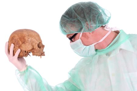 funny doctor: Details surgeon with skull on white background