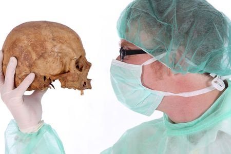 Details surgeon with skull on white background photo