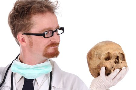 Details doctor with skull on white background photo