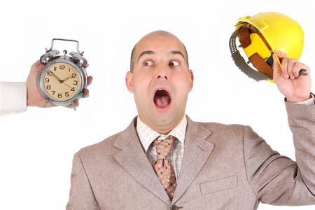 confused a businessman looking at clock alarm photo