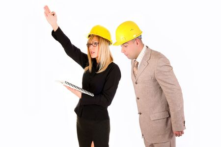 angry businesswoman and architect looking at architectural plans photo