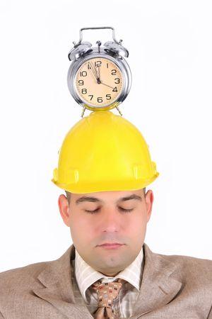 sleepy businessman with clock alarm on his head  photo