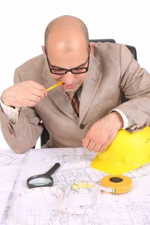 Businessman thinking with architectural plans on white background Stock Photo - 2942308