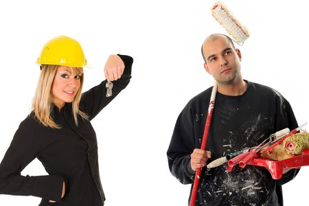 businesswoman with keys and house painter with paint roller photo