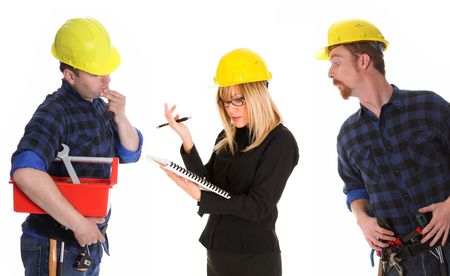 angry businesswoman and construction workers with architectural plans photo