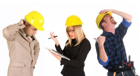 angry businesswoman and architect with architectural plans and construction worker tittering photo