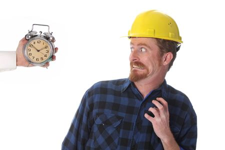 confused construction worker looking at his watch photo