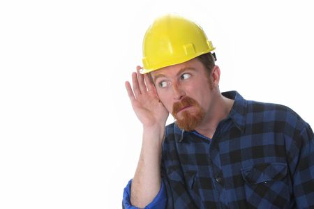 construction worker with hand on ear on white background photo