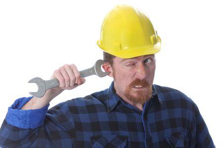 journeyman technician: construction worker handle double wrench on ear
